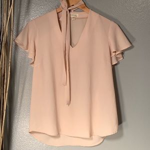 Monteau cream blouse with tie neck, size Large